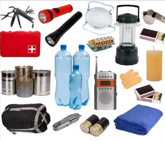 flashlight, first aid kit, bottled water, canned food, sleeping bag, blanket, matches etc